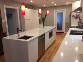 Quartz Noble Supreme White counters with waterfall edge on island